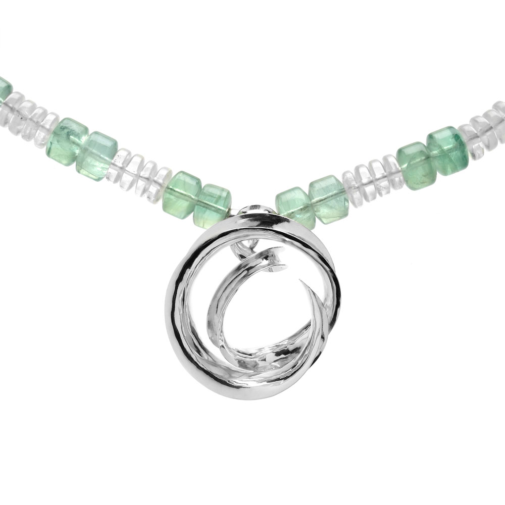 Anticlastic raised silver necklace with green fluorite and rock crystal beads.