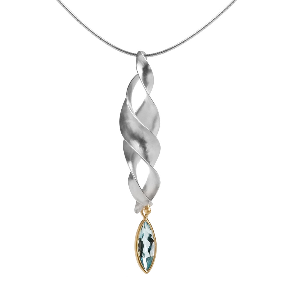 Anticlastic raised silver pendant with a marquise blue topaz set in 18ct yellow gold.