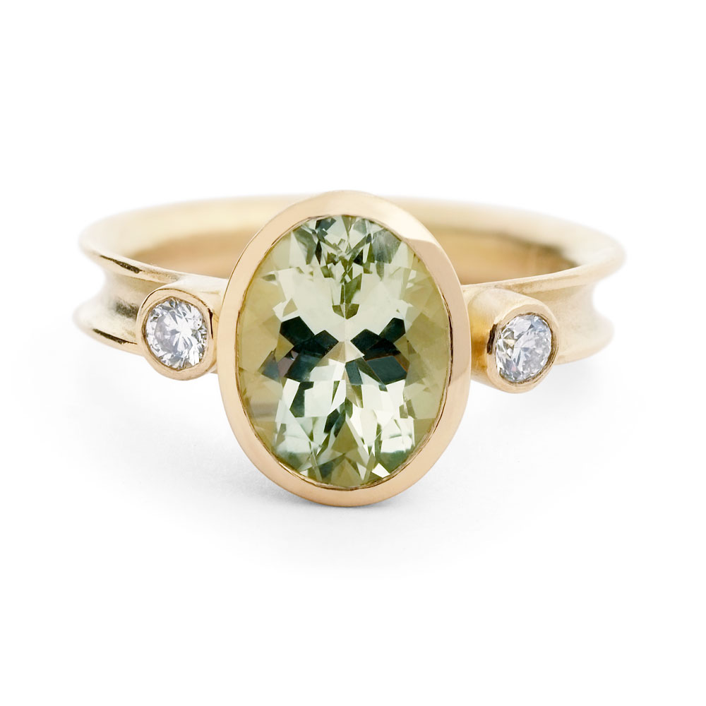 Anticlastic raised 18ct yellow gold ring with oval beryl and 2 x diamonds.