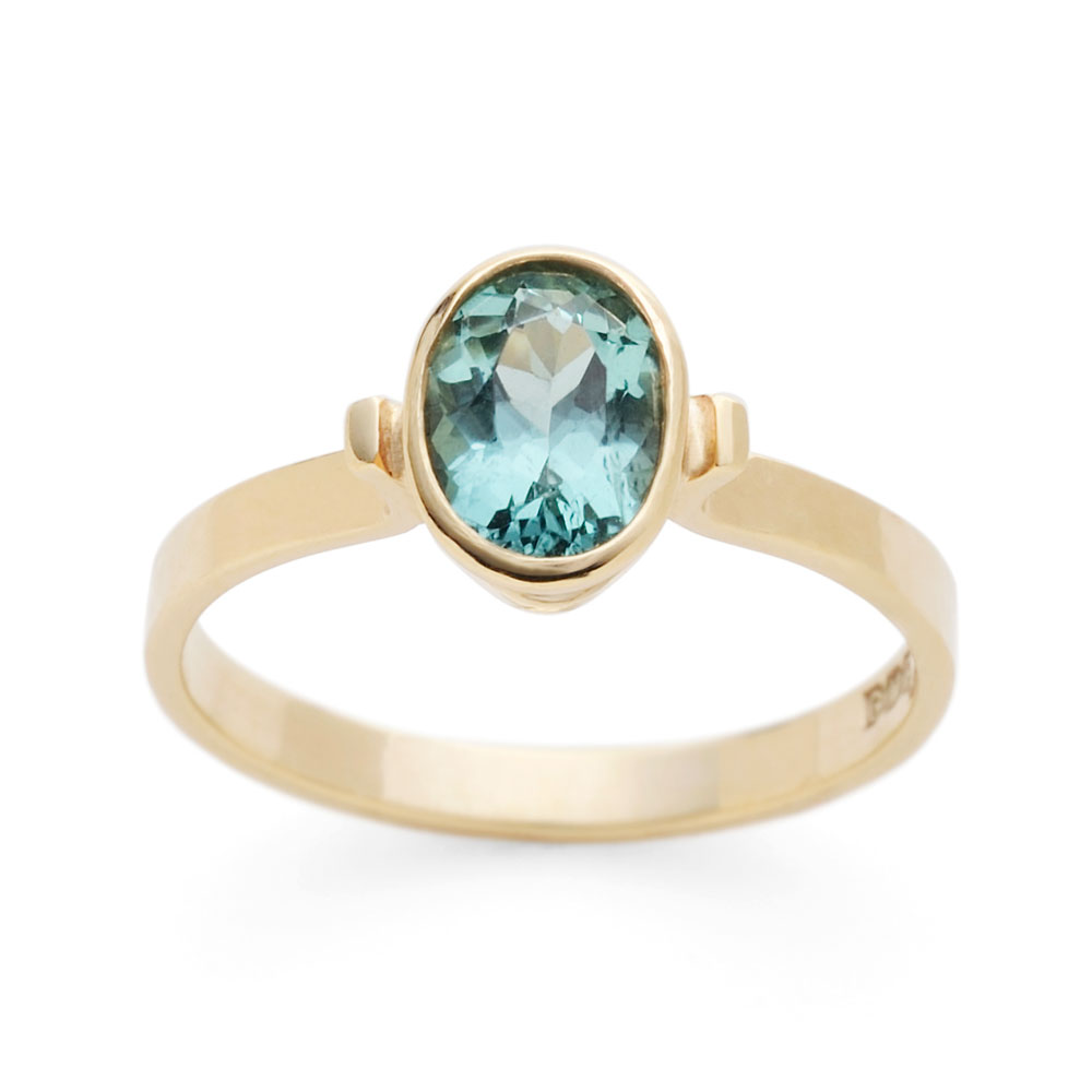 Ring with blue tourmaline in 9ct yellow gold.
