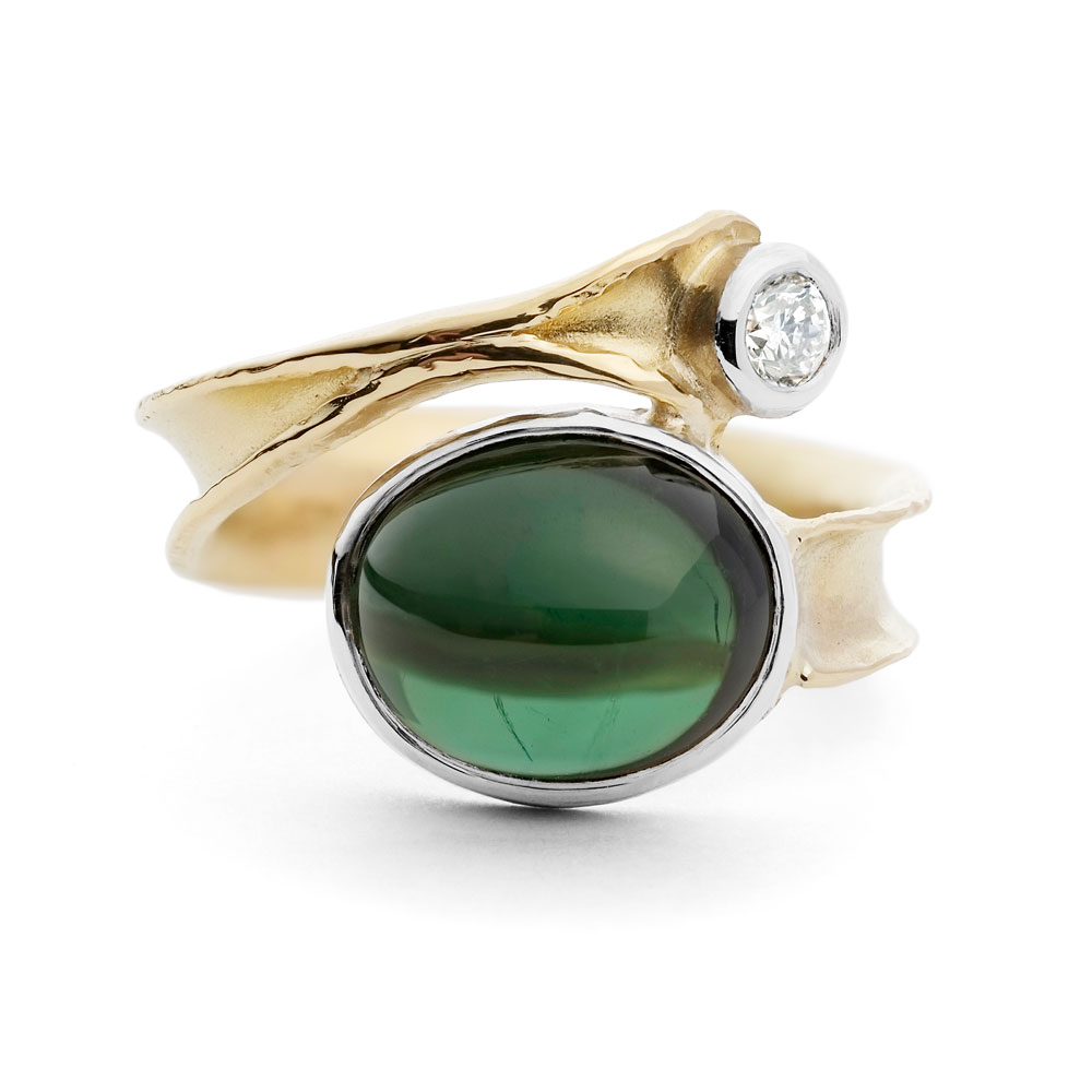 Oval green tourmaline cabochon, 1 x diamond in 18ct yellow and white gold anticlastic raised & forged ring.