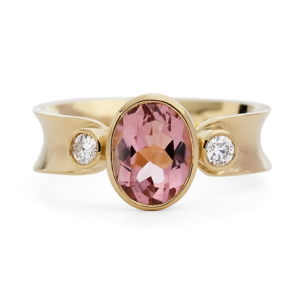 Oval pink tourmaline, 2 x diamonds in 18ct yellow gold anticlastic raised ring.